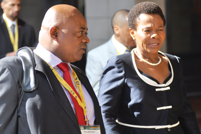 South African Mineral Resources Minister Susan Shabangu, with aide, arrives at the conference.