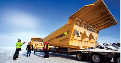 A shipment of haul truck bodies arrives at the Gahcho Kue' diamond mine—one of almost 800 freight deliveries expected by the end of March. (Photo courtesy of De Beers)