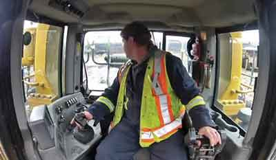 Video footage shows trainees where the operator's hands are positioned and how he turns his head to check for other equipment.