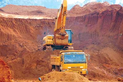 Mining the iron-rich overburden at Mengapur.