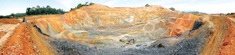 The open pit at Monument Mining's Selinsing gold project. The company has almost depleted the open-pit oxide reserves at Selinsing.