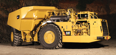 Cat-AD60-underground-truck-with-diesel-particulate-filter-on-deck-above-tire