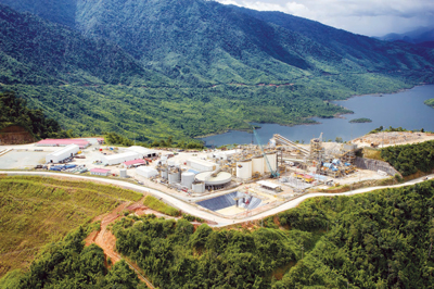 An aerial view of the Ban Houayxai process plant with Nam Ngum Reservoir in the background.
