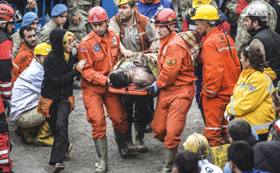 Rescuers bring victims to the surface at the Soma mine, where 301 miners died.