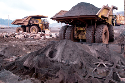 A protective grid system developed by iron ore producer Vale protects crusher-station equipment from damage by oversize boulders dumped from haul trucks.