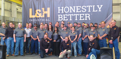 The employees at L&H Industrial's Tempe facility commemorate an expansion. Garrett Goldman is the general manager (far right).