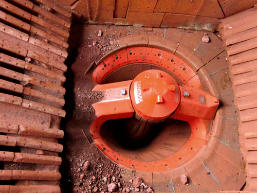 A Sandvik CG820 gyratory crusher, showing the intake, spider arms and cap, and rim liners.