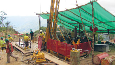 Drilling in the rugged terrain of the Crater Mountain project in
