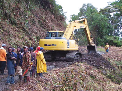 Construction of a road within the Crater Mountain project.