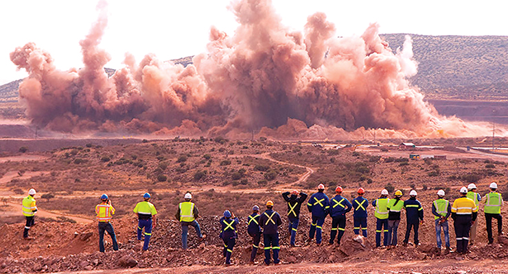 Onlookers observe a blast at Kumba Iron's Kolomela mine that freed up more than 2 million metric tons of waste for removal. (Photo: Kumba Iron Ore)