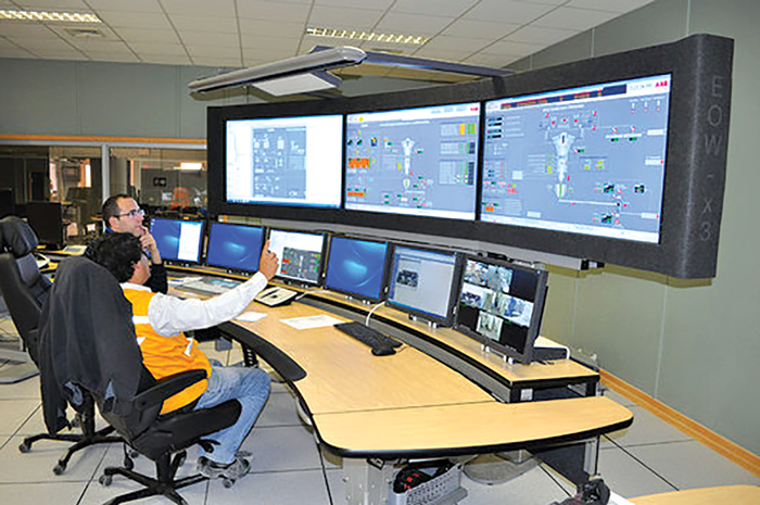 Operators scan plant control screens during the early stages of production at KGHM's new Sierra Gorda mine in Chile. (Photo:KGHM)