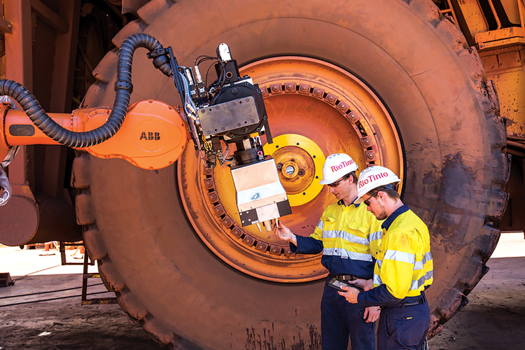 Rio Tinto is investigating the potential advantages of autonomous tire-changing equipment.