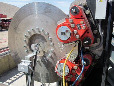 Spring-applied, hydraulically-released BSFH 520 brakes act on a 1.6 m diameter disc mounted on the low-speed side of the drive shaft. The brake system provides up to 182,160 Nm nominal braking torque to stop the conveyor in a controlled manner over a 50-second time period.