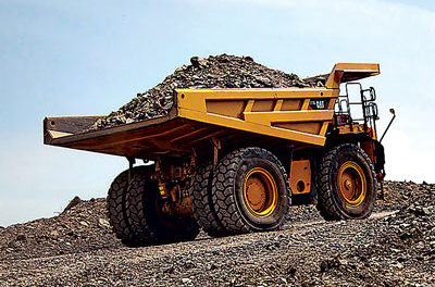 Cat Restructures Mining Business, Plans Further Layoffs and Cost Reduction Moves