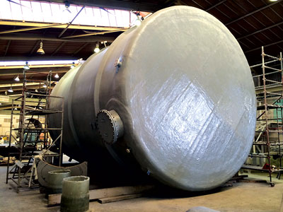 This 19-ft-diameter, 36-ft-long GRP tank is going into service in a solvent extraction circuit at the Husab uranium mine.