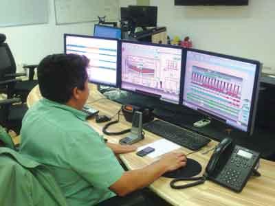 One of three technicians tracks performance at Vargem Grande's control room.