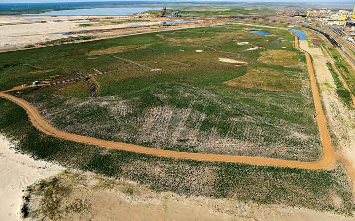 Under reclamation: the 17-ha Sandhill Fen TSF, for which Syncrude won an Emerald Award earlier this year.