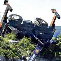 Ground failure and not using proper outrigger pads are major causes of cranes overturning during a lift.