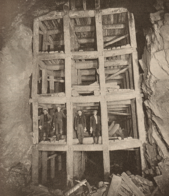 The photo shows square set timbering at the Homestake mine in Lead, South Dakota. The lithograph above also demonstrates the immense size of the square set timbering.