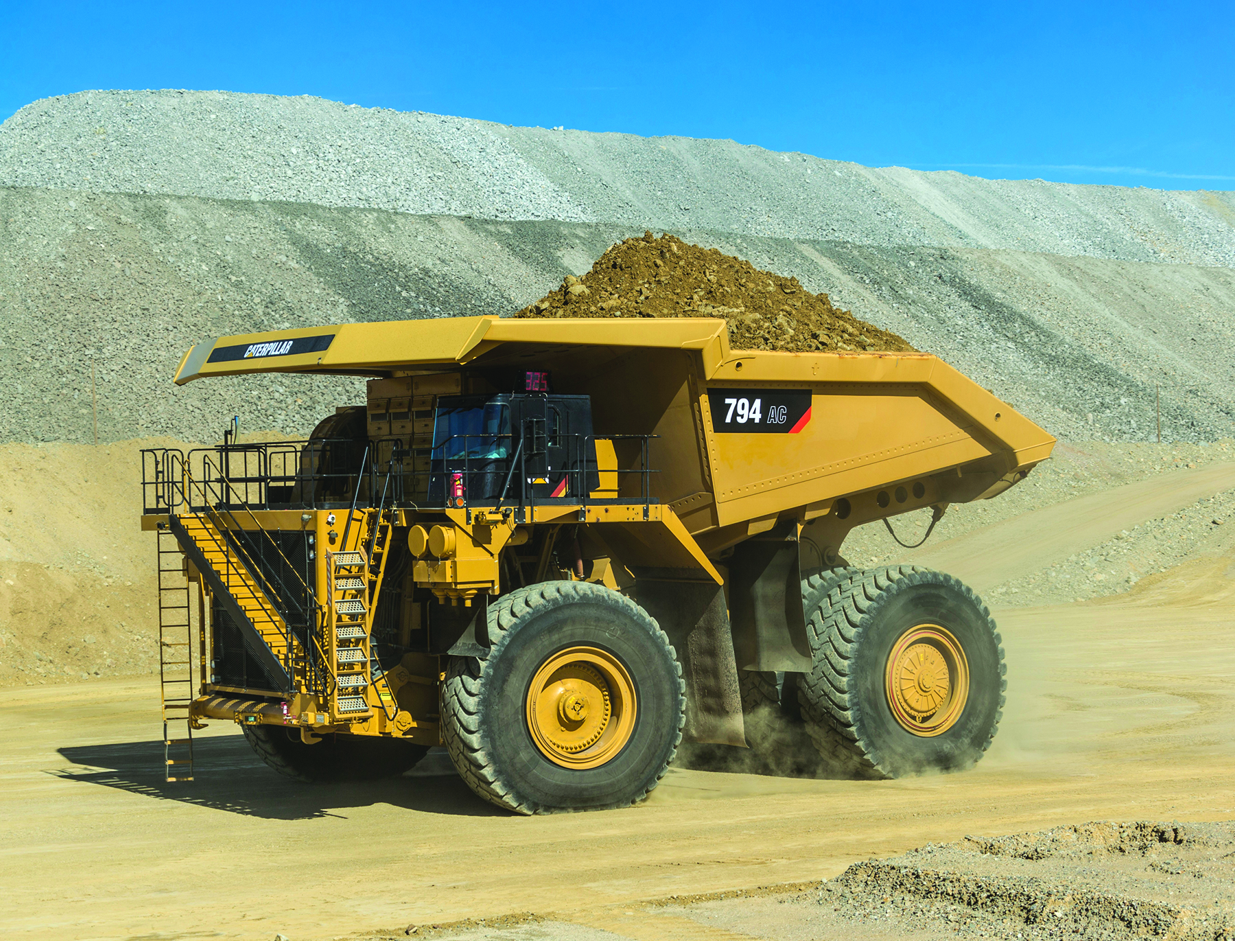 Cat's new 794AC shares AC drive system characteristics with the larger 795AC.