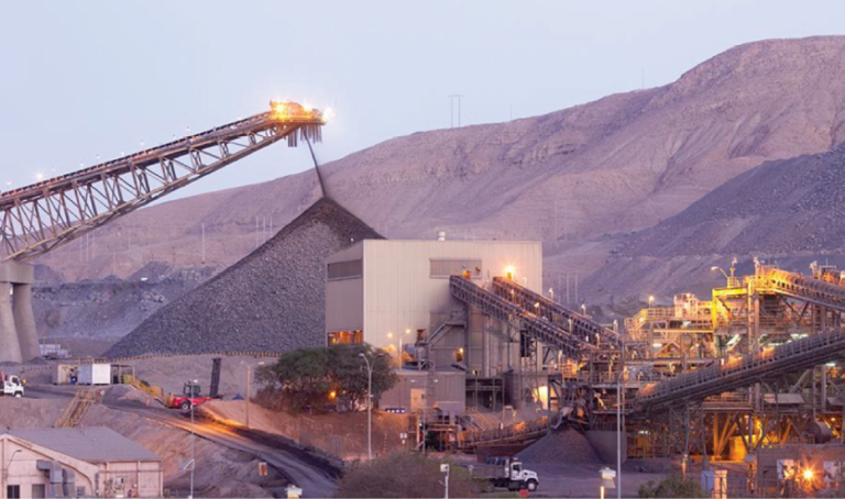 The 75,000-mt/d concentrator is fed from a 450,000-ton-capacity crushed-ore stockpile.
