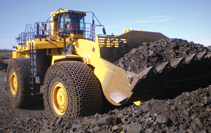 Originally developed to protect construction-machine tires from broken pavement fragments left by bombing in WWII, Erlau AG's tire chain designs now shield both small and large loader tires from mine-site rock hazards while improving traction on slick surfaces.